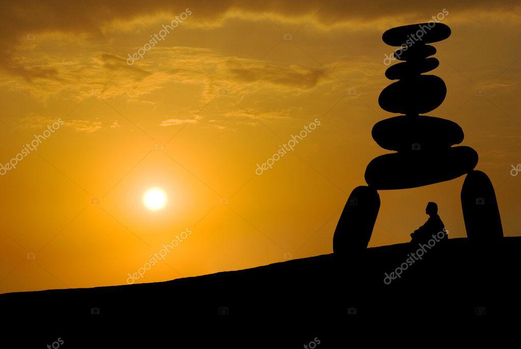 Face huge stress, meditation under sunset