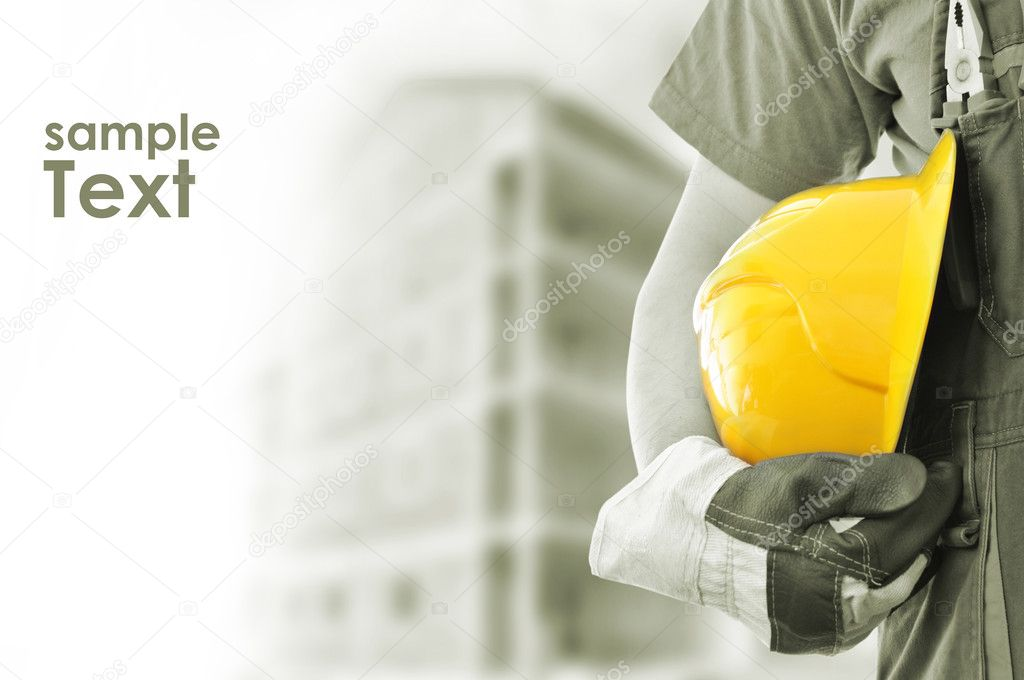 Worker and the blurred construction in background with space for your text stock vector