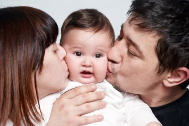 Baby with parents on a white background