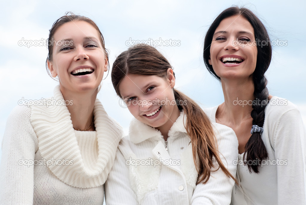 Three young woman enjoying autumn