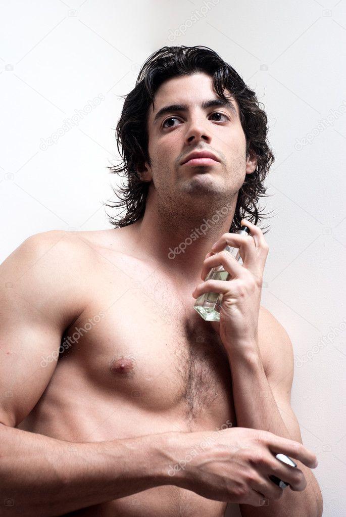 Cosmetic wellness spa man spraying fragrance