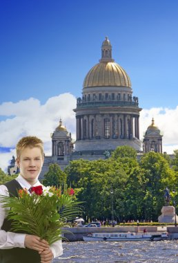 The pupil in a school uniform with a bunch of flowers in the center of Pete
