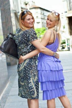Two girlfriends in city. stock vector
