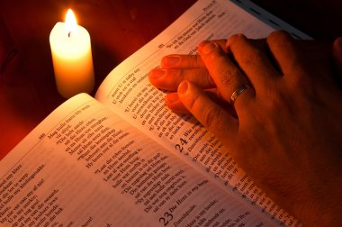Bible by candle light