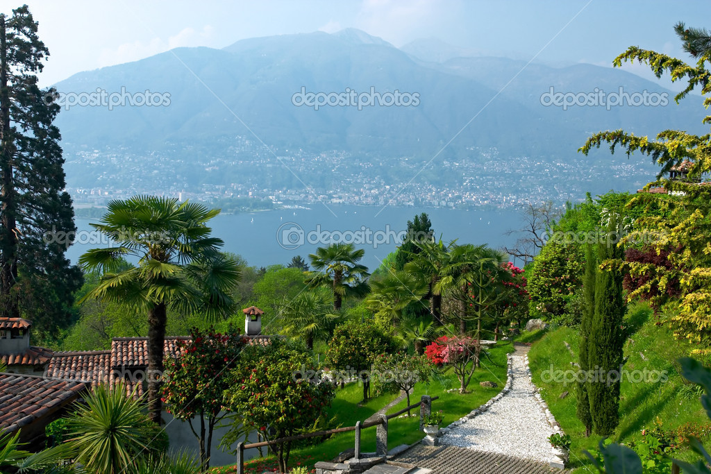 View over Lago Maggiore with beautiful park and houses on the fo