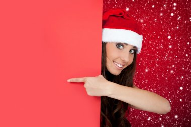 Santa girl in snow with blank billboard