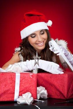 Santa girl wrapping chrsitmas present