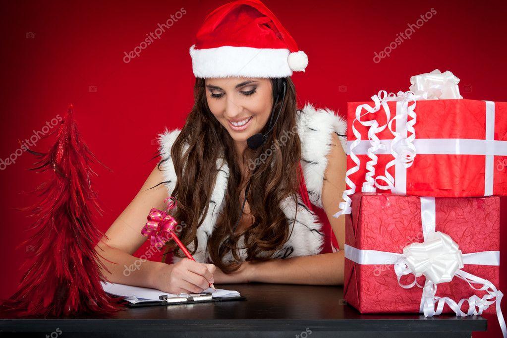 Santa girl making list of christmas present wishes