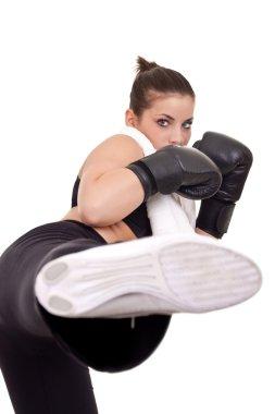 Girl giving kickboxing hit