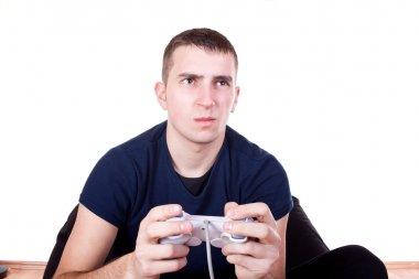 Furious young man with a joystick