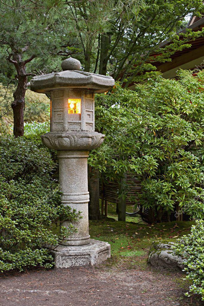 Stone lantern at japanese garden 2 stock photo davidgn for Japanese landscape lanterns