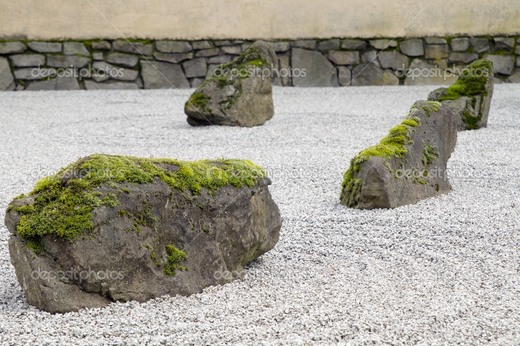 Japanese stone and sand garden closeup stock photo for Japanese garden stones
