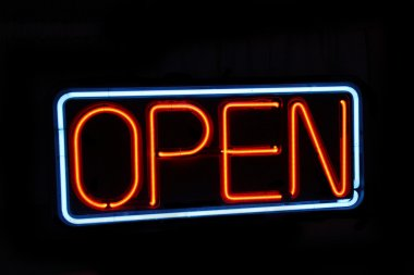 Neon open sign against black