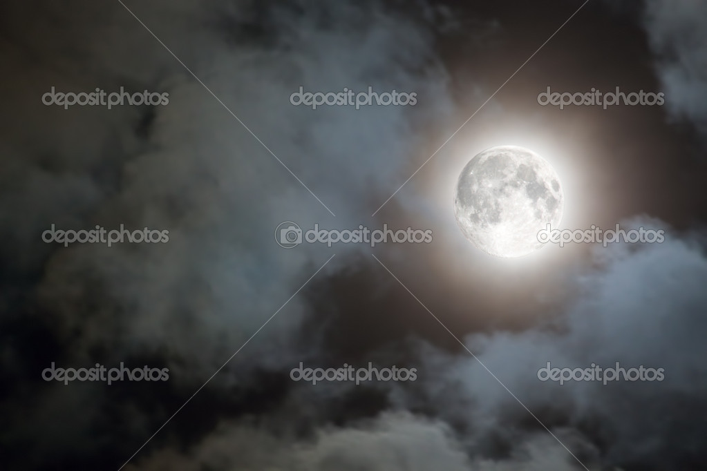 Full moon and white clouds at night