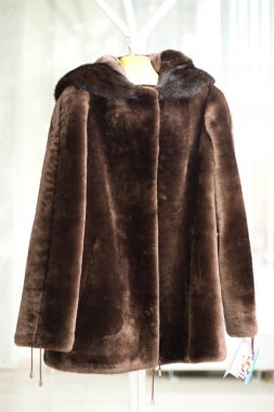 Female warm fur coat from a muton