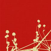 Hlavy semeno a stonky na červeném pozadí žebrované