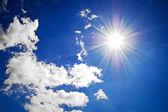Blue summer sky with sun
