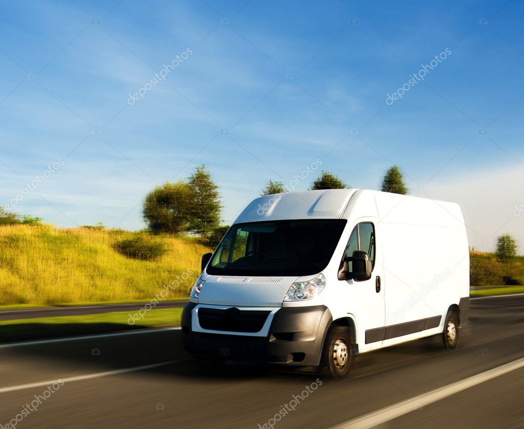White delivery van on gighway