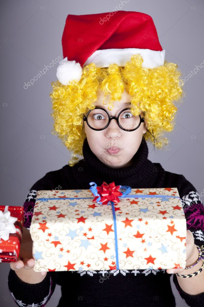 Funny girl in glasses with christmas gifts.