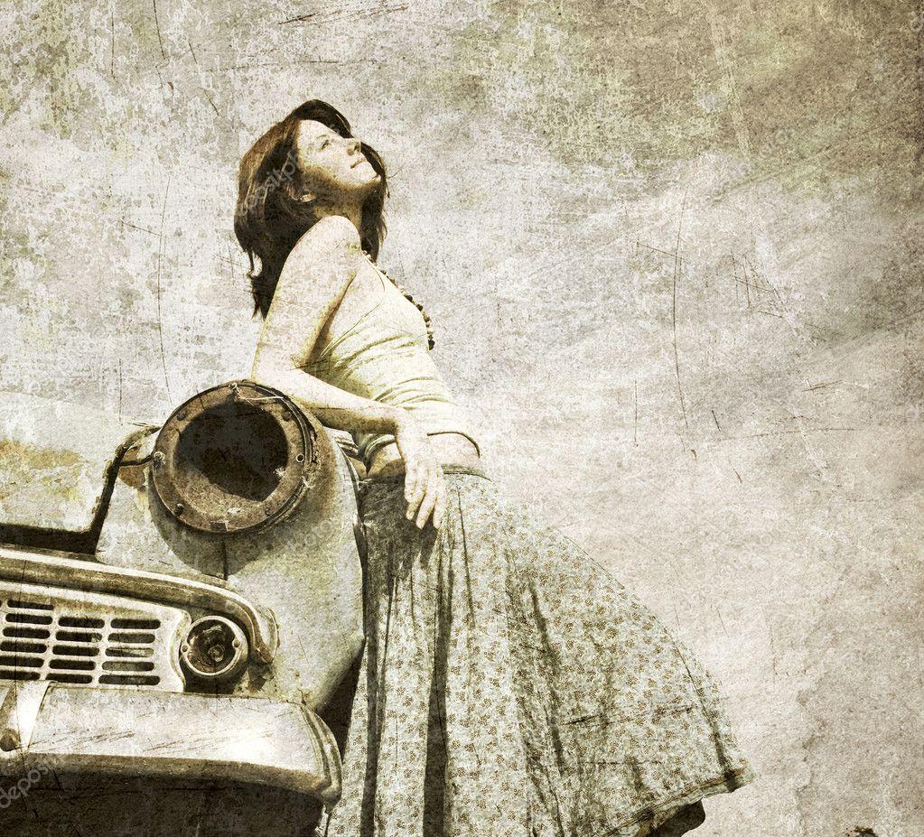 Girl near retro car.