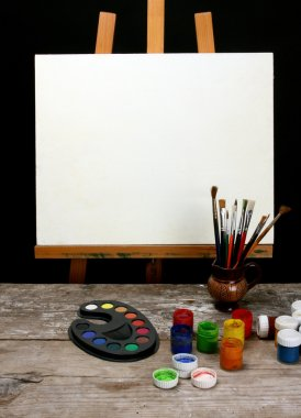 Canvas,brushes and easel