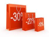 Fotografie einkaufen rabatt konzept. rote taschen isoliert auf weiss