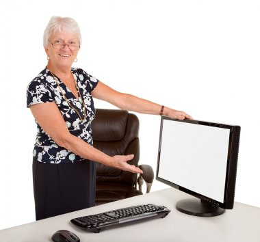 Senior Businesswoman Pointing at a Blank Monitor