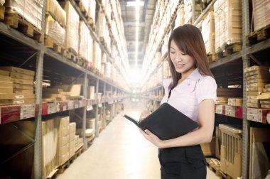 Asian girl in warehouse