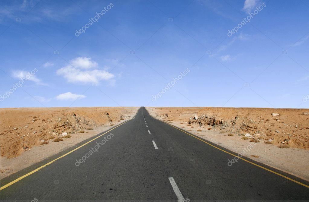 Neverending lone desert road