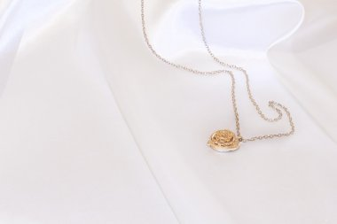Gold pendant on white background