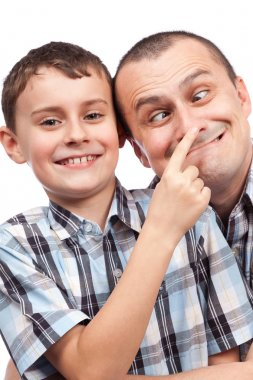Father and son making funny faces