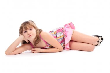 Little girl lying down, isolated on white