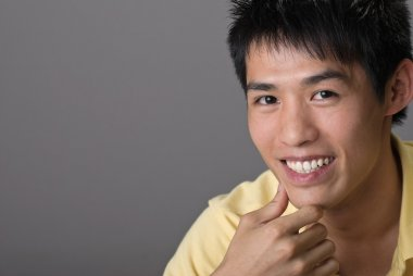 Smiling Asian young man
