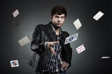 Portrait of the young man playing cards