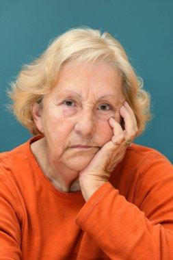 Senior woman sulking