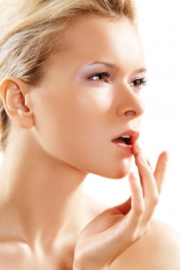Health & skin care. Lovely woman touching her lips