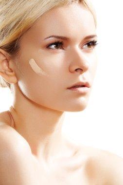 Skin care and cosmetics. Woman applying skin tone foundation