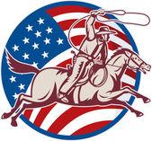 Cowboy auf Pferd mit Lasso und amerikanische Flagge