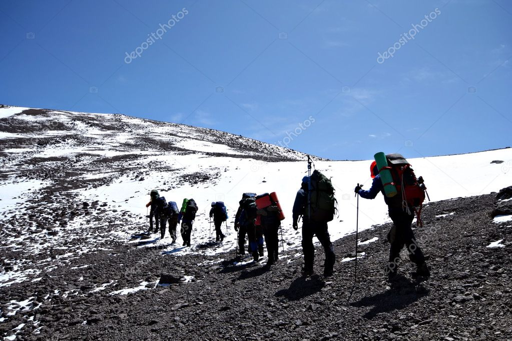 Alpinists at the climbing in Caucasus mountains