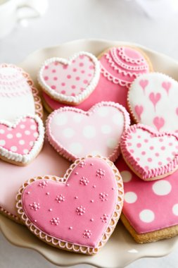 Heart shaped cookies with pink and white icing stock vector