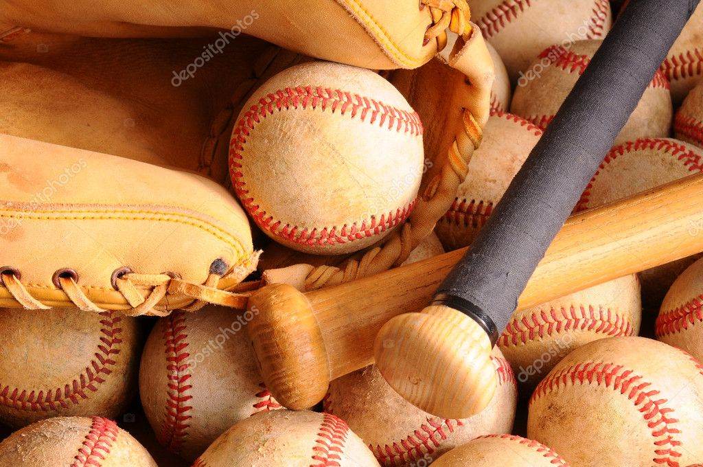 Close Up Of Vintage Baseball Equipment Horizontal Format With Two Wooden Bats And Catchers Mitt On Top A Pile Old Worn Baseballs Photo By Scukrov