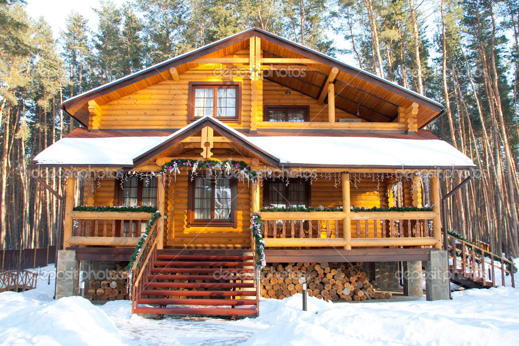 Christmas wooden mansion at pine forest