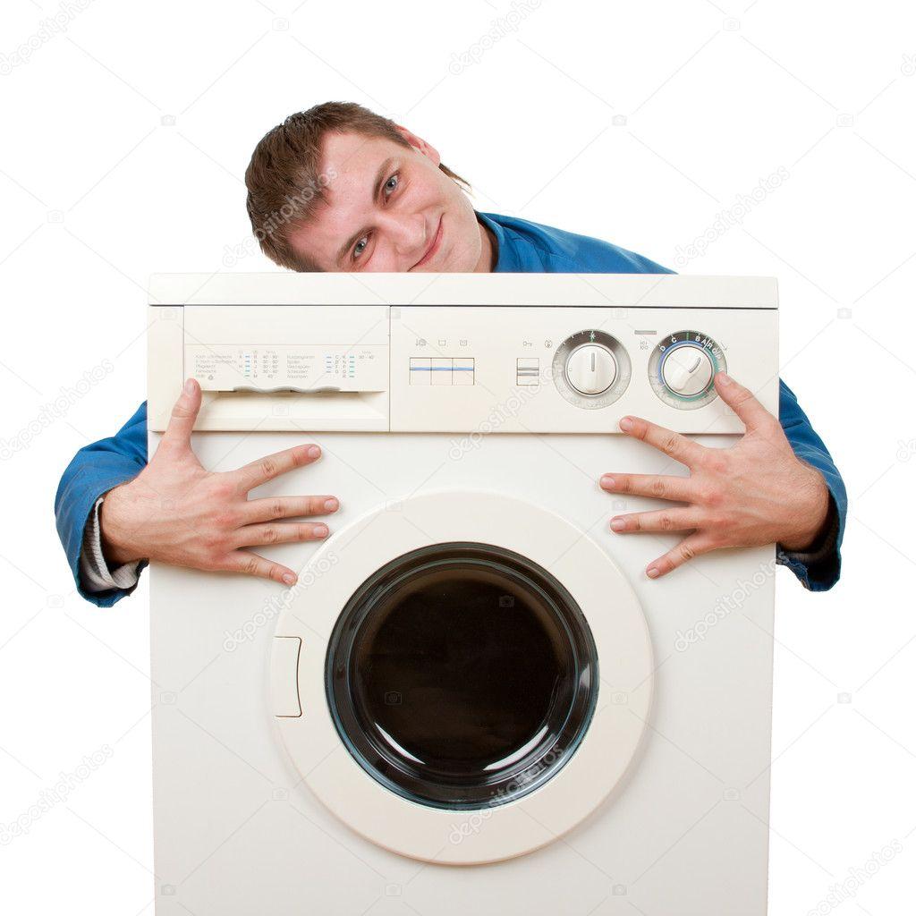 Repairman embraces washing machine. Isolated on white