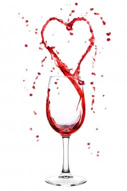 Wine splashing from wineglass in heart shape