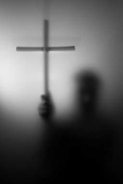 Silhouette of saint with cross
