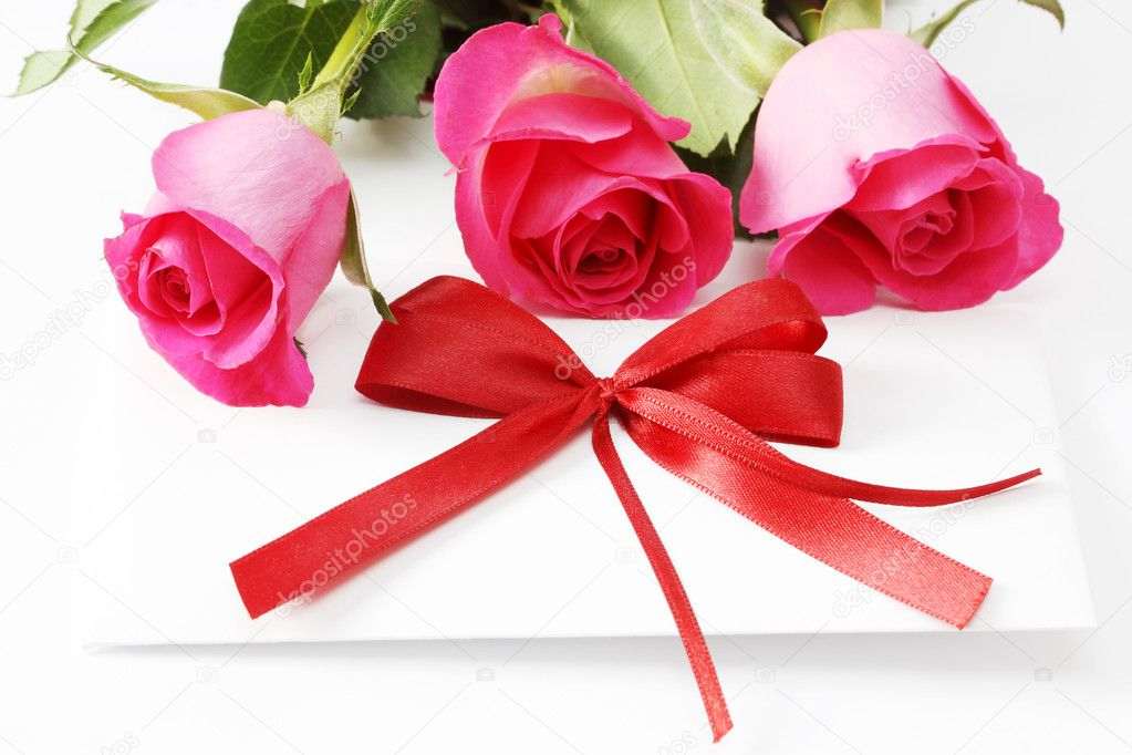 Invitation card and roses