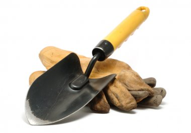 Old Dirty Leather Work Gloves and Trowel