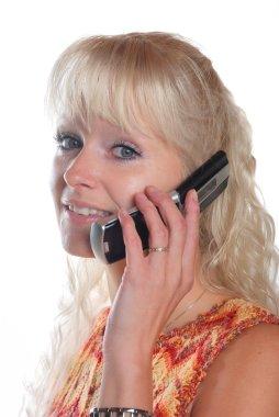 Portrait of blond woman phoning