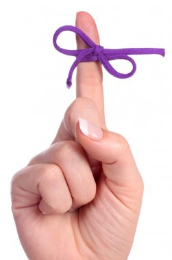 A finger contains a bow-tied string as a reminder