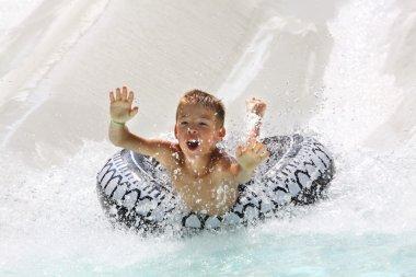 Boy having fun in water park
